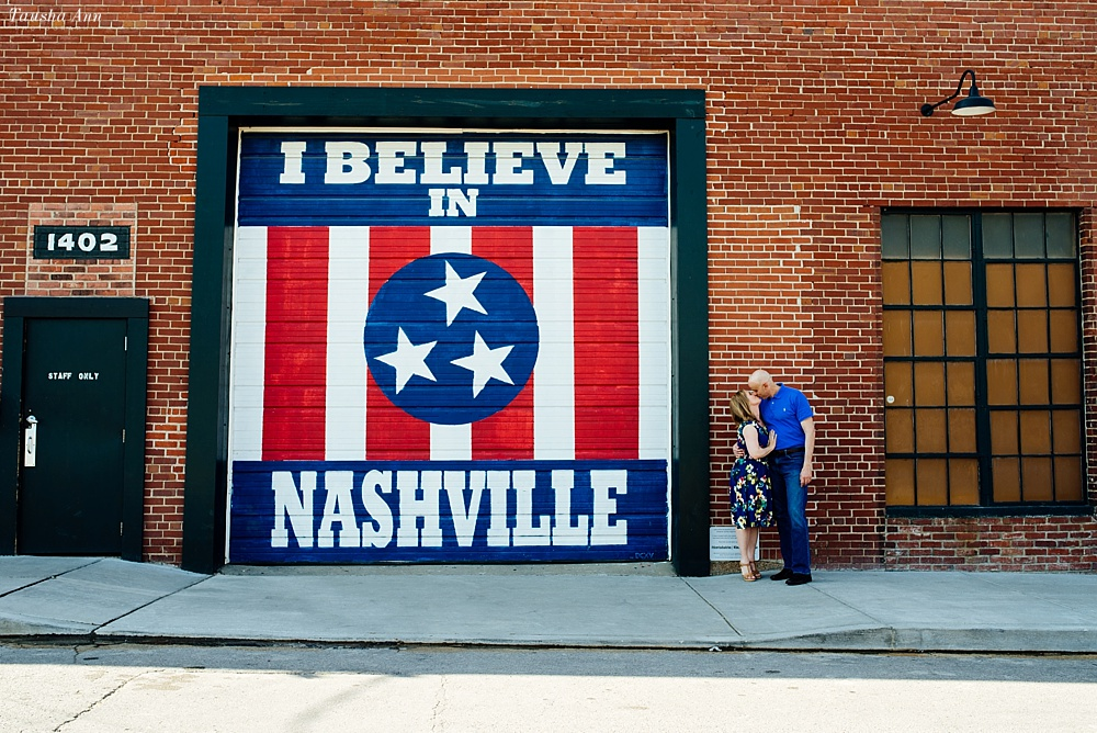 Couple kissing next to the I Believe in Nashville Sign at Marathon.