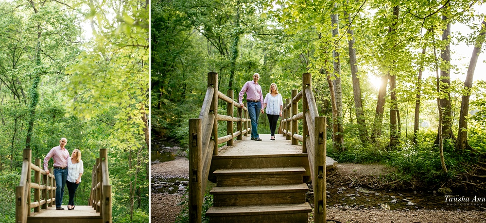Couple standing on bridge over small stream at Percy Warner Park in Nashville TN