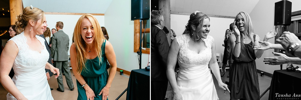 Bride having a great laugh with a friend at reception.