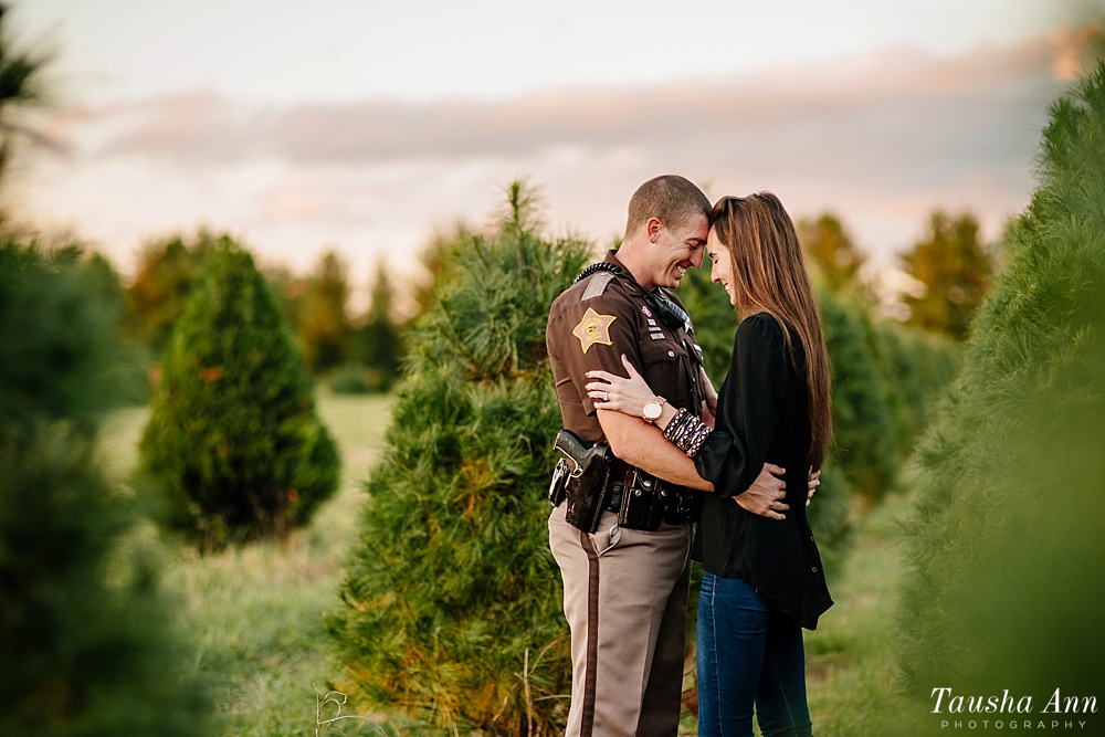 Surprise Proposal at Country Cove Christmas Tree Farm. Police officer surprise proposal at Sunset. Forehead to Forehead between Christmas Trees.