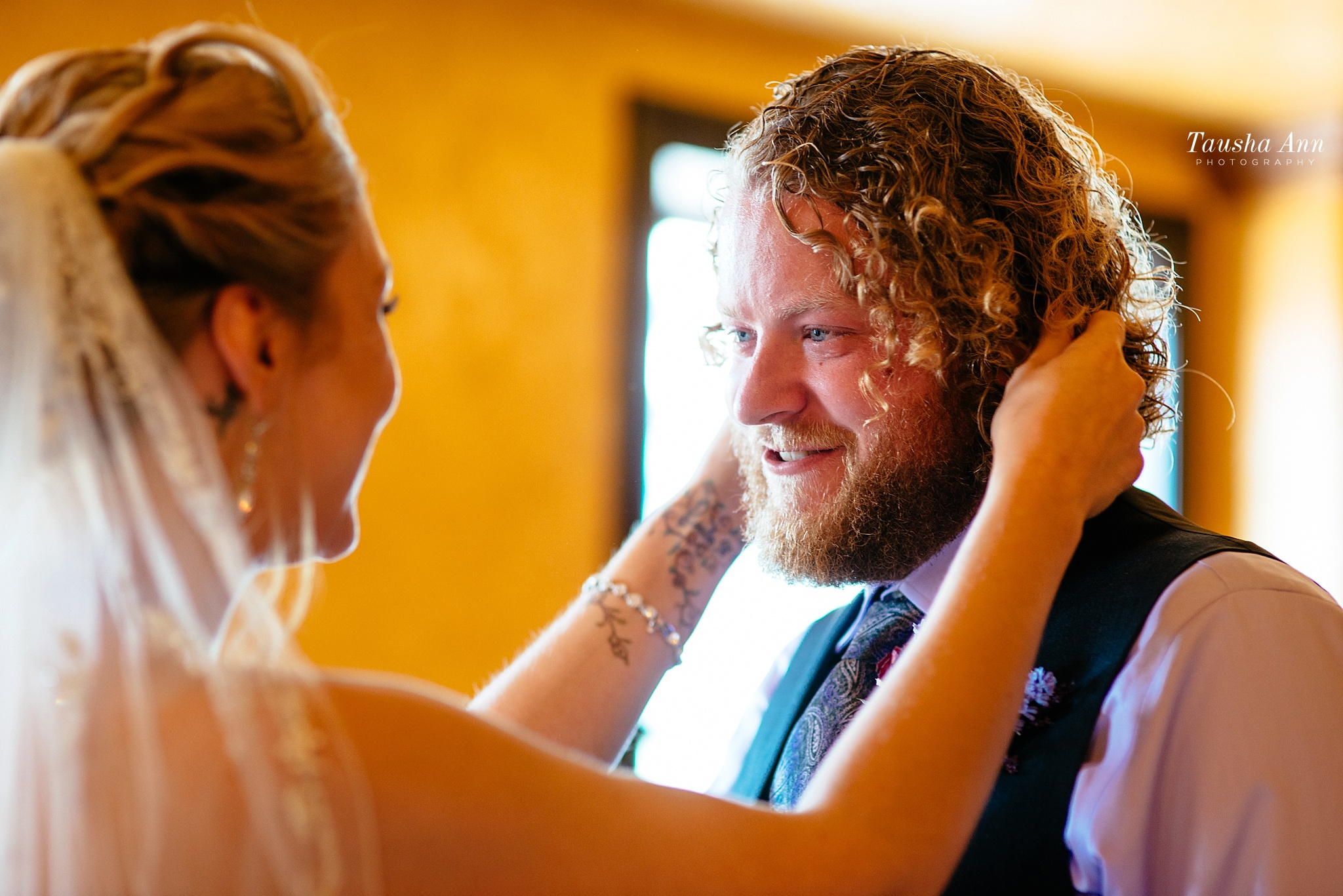 Groom seeing bride for first time. Tear running down his face.