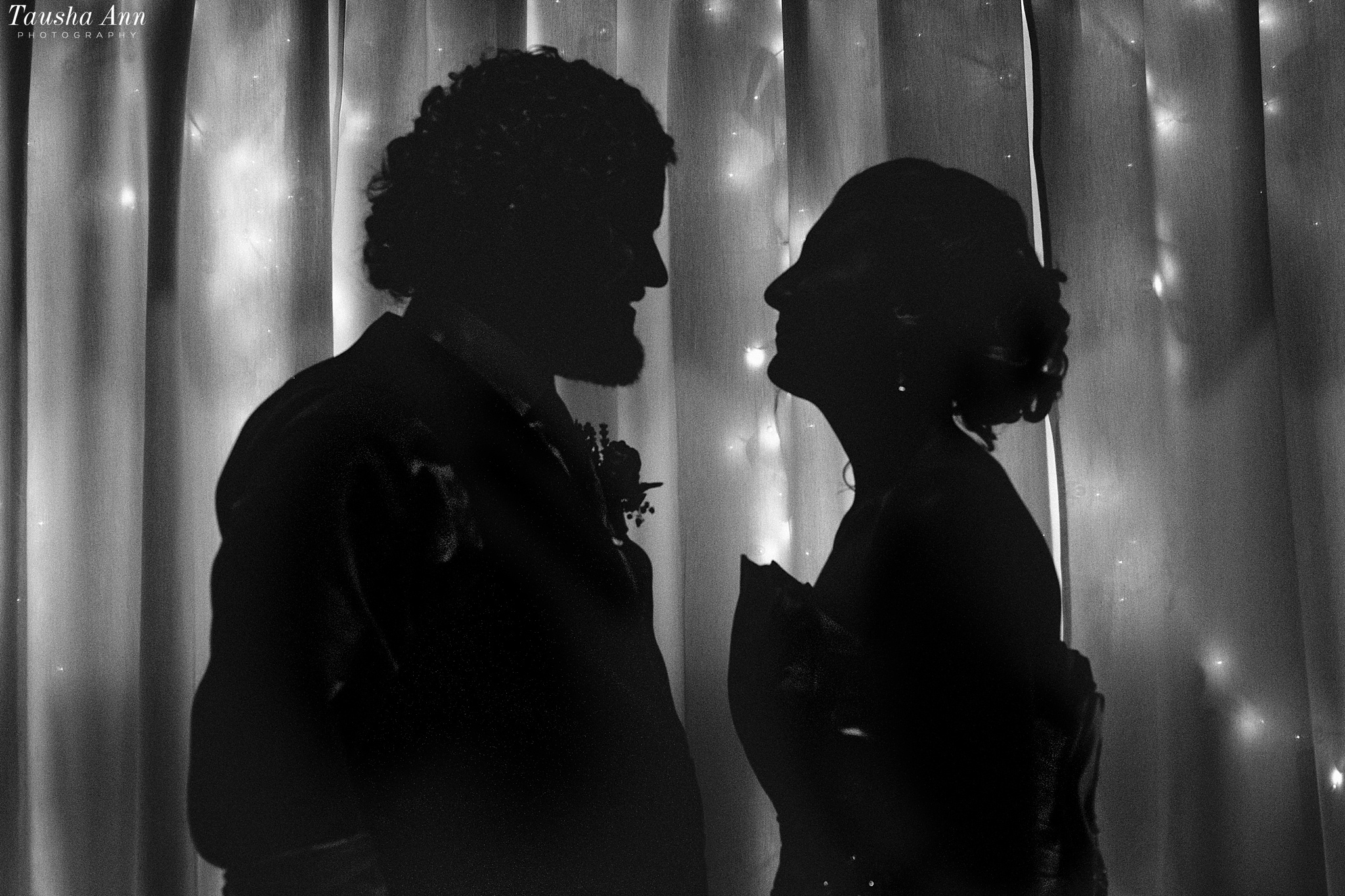 Silhouette image at The Shiloh. Black and White with lights in background.