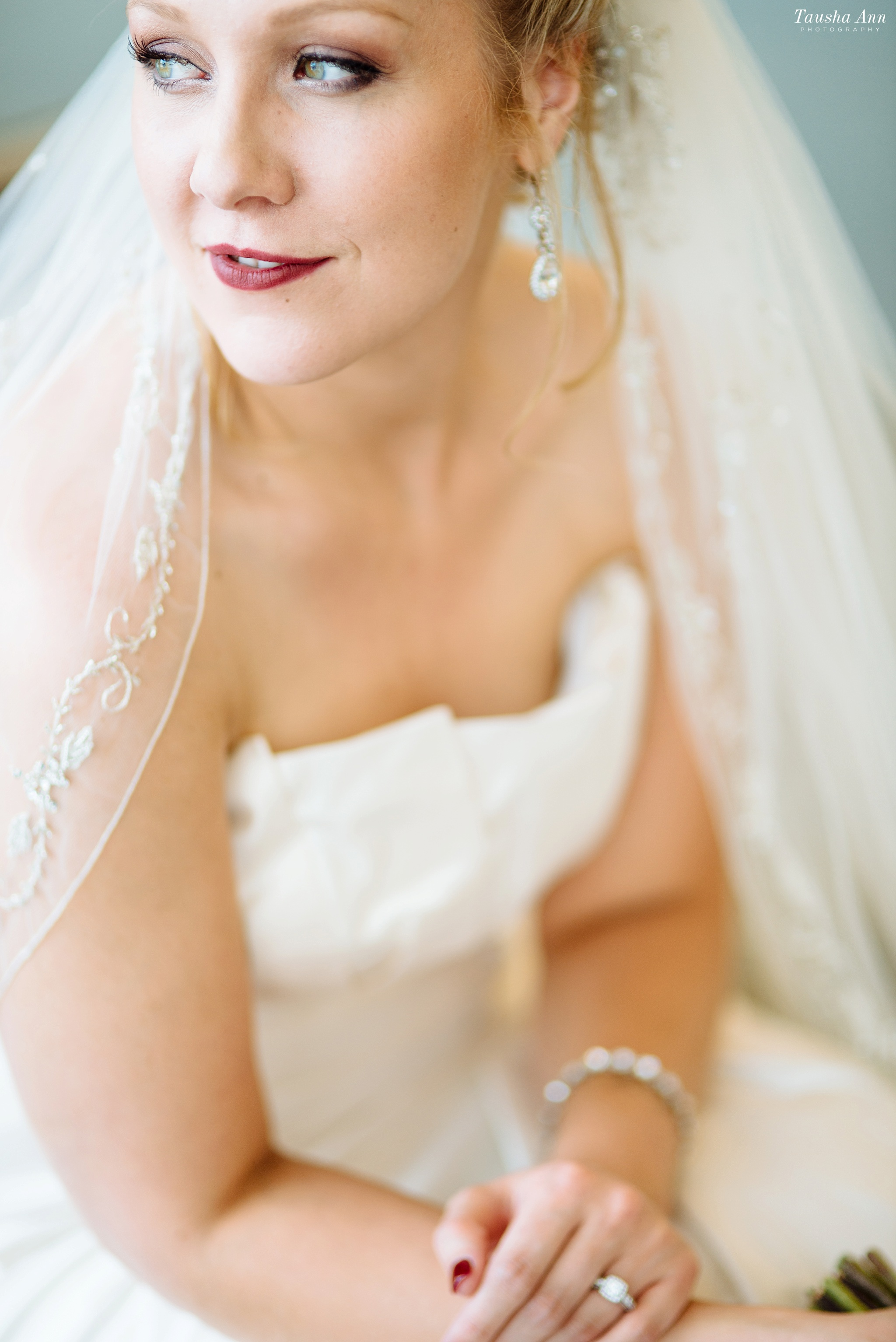 Stunning editoral image of bride looking away from camera. Very shallow depth of field.