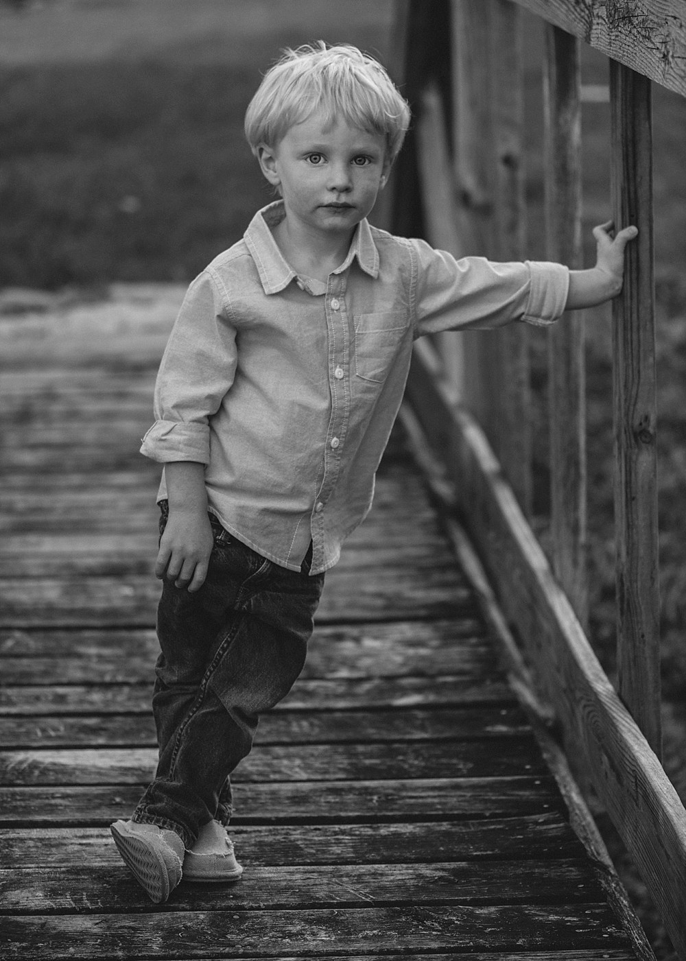 Boy in black and white, posed very cute on wooden bridge, Nashville Family Photographer