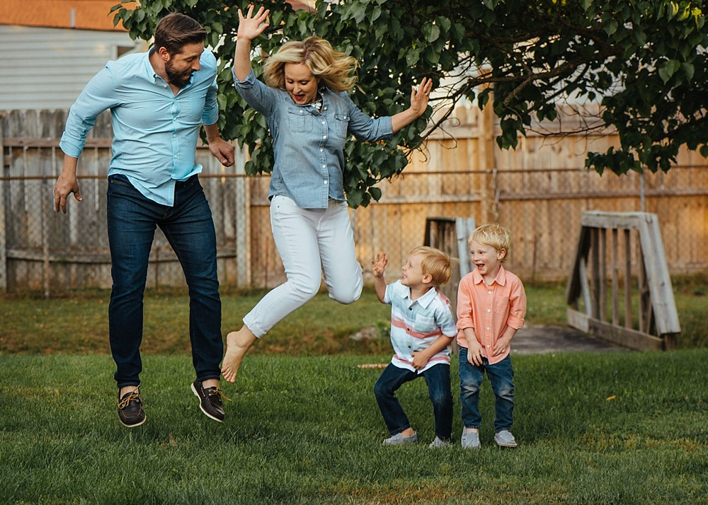 Family jumping for joy in their backyard