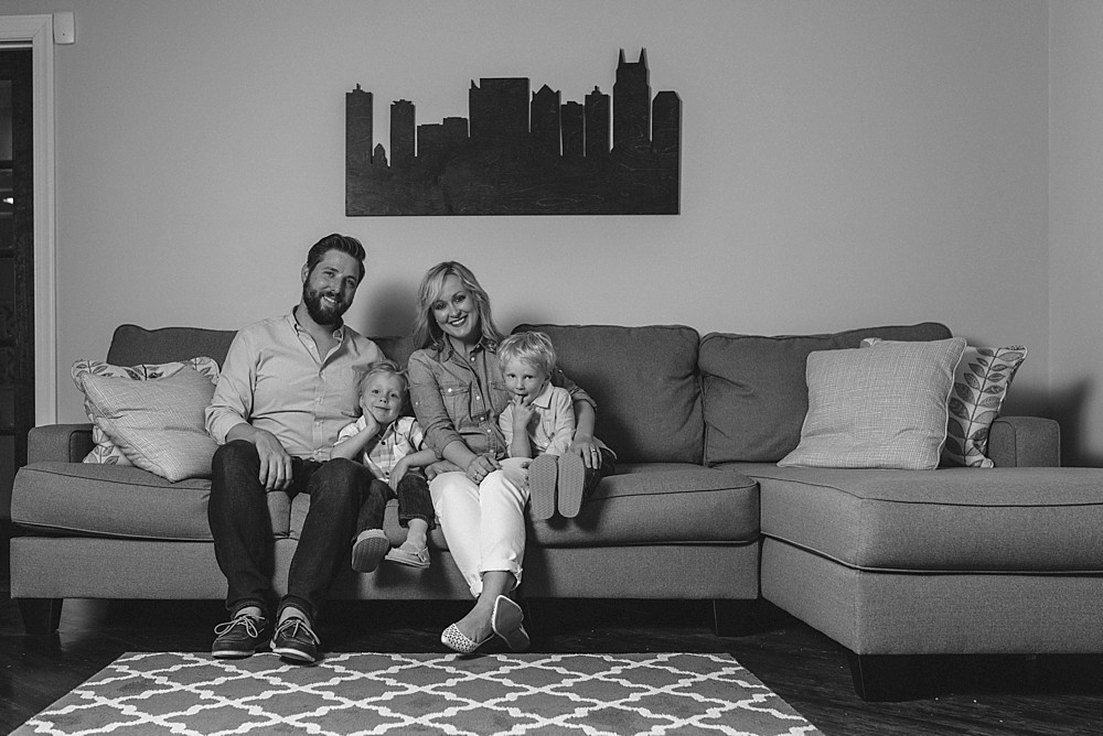 Photo of family on couch with Nashville Skyline art