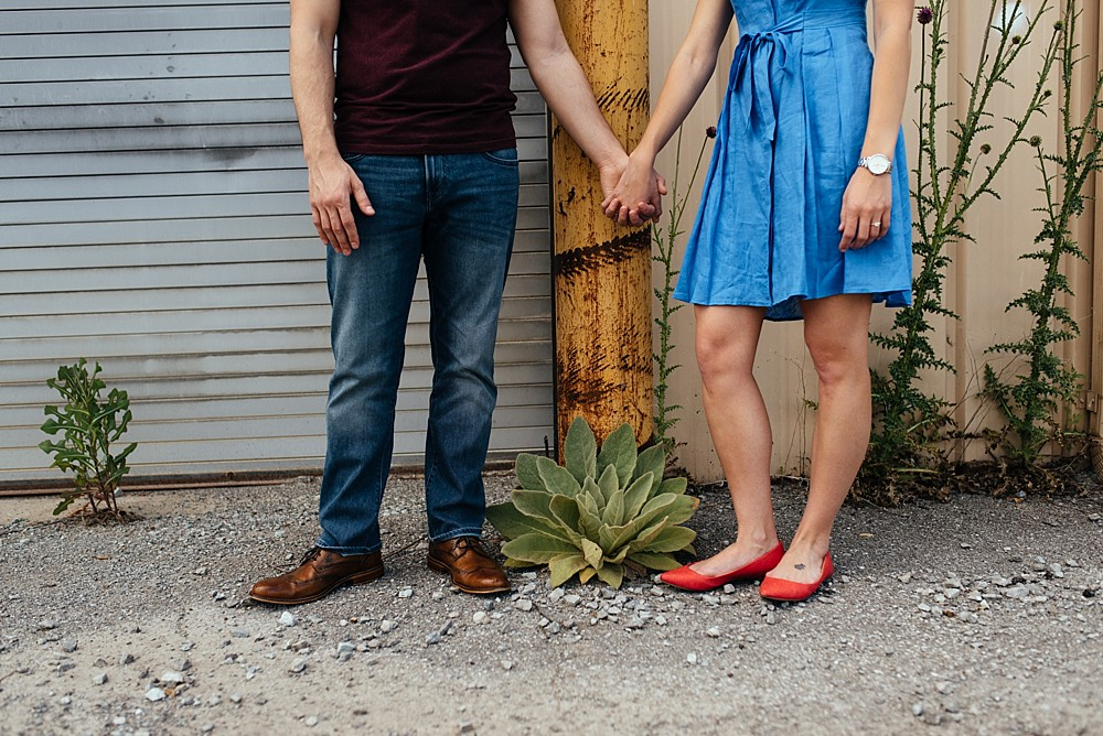 Couple holding hands, urban setting Nashville-Wedding-Photographer-Engagement_Photos_Downtown_Franklin_TN_Tausha_Ann_Photography_0004