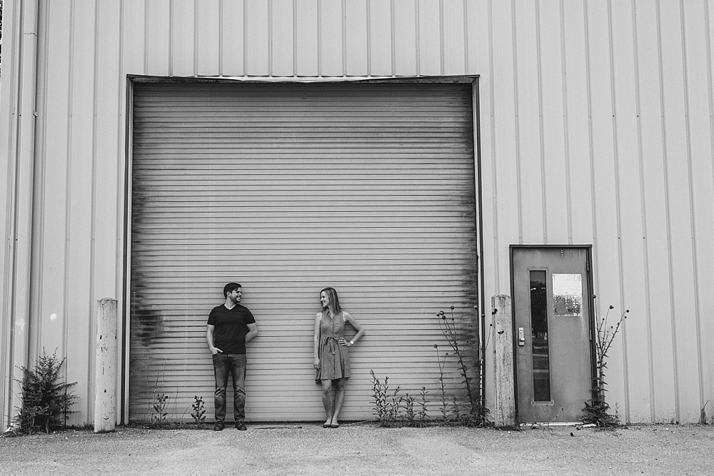 Couple against garage doors - black and white - Nashville-Wedding-Photographer-Engagement_Photos_Downtown_Franklin_TN_Tausha_Ann_Photography_0006