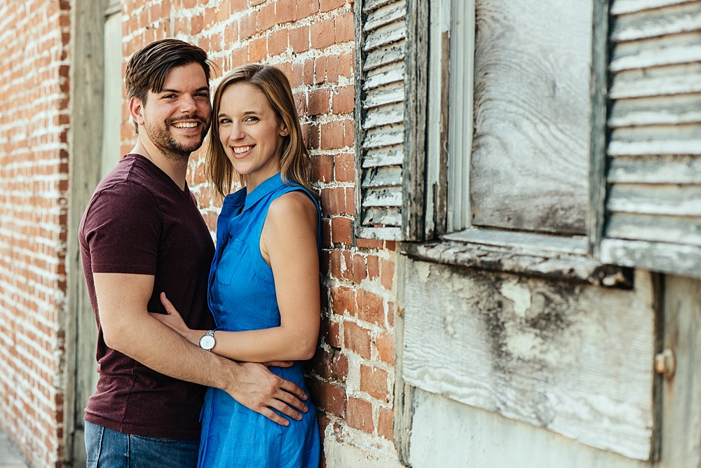 Couple looking at camera - brick wall - Nashville-Wedding-Photographer-Engagement_Photos_Downtown_Franklin_TN_Tausha_Ann_Photography_0006