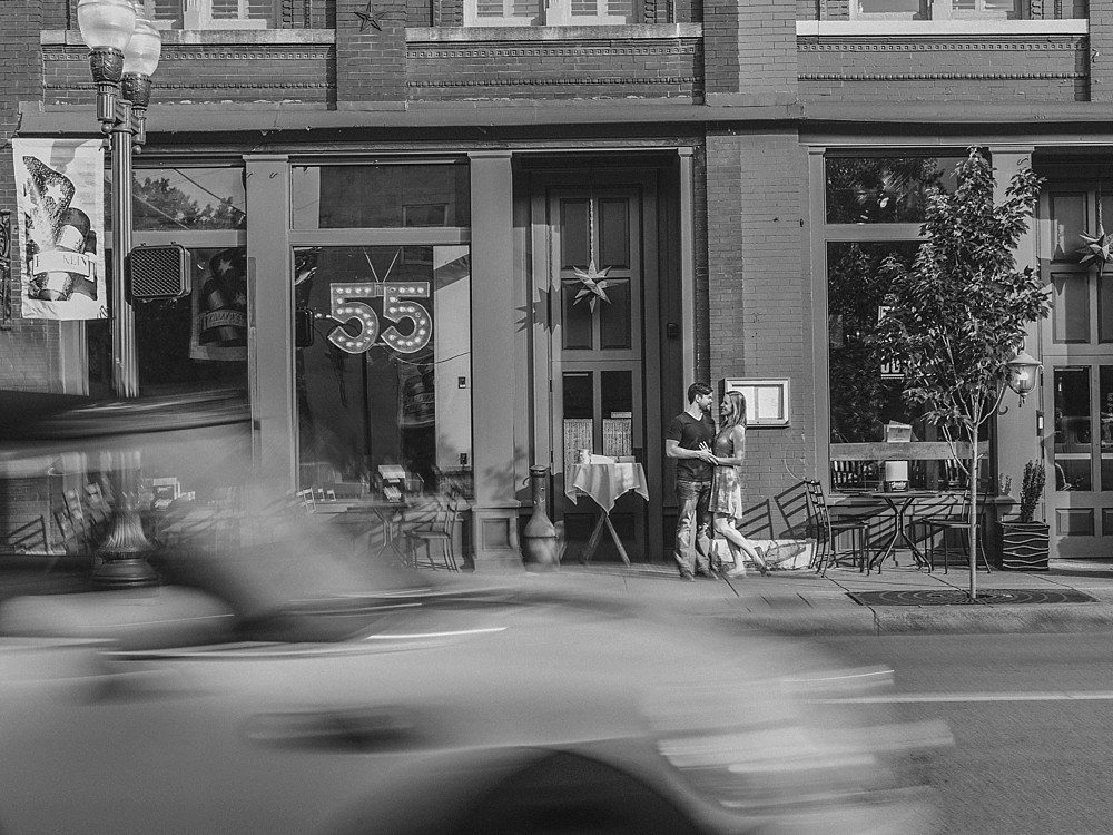 Downtown Franklin - 55 south - Nashville-Wedding-Photographer-Engagement_Photos_Downtown_Franklin_TN_Tausha_Ann_Photography_0006 - black and white - car driving by blurred out.