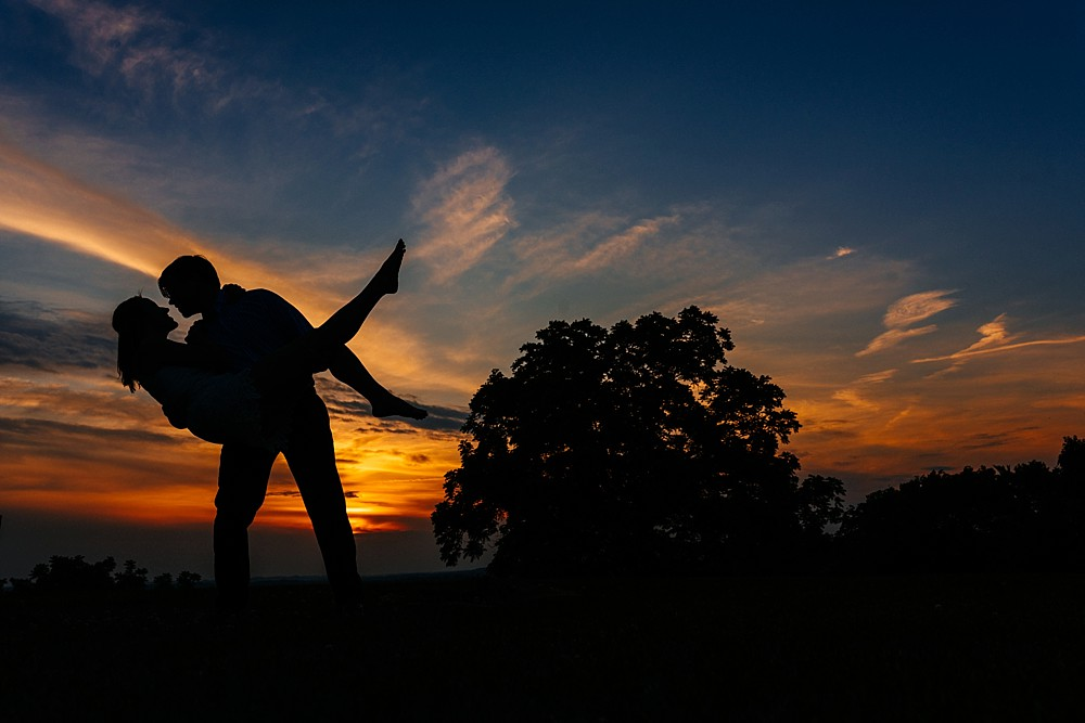 Silhouette with clouds - sunset - Couple almost kissing - Arrington Vineyards, in the vines - Nashville-Wedding-Photographer-Engagement_Photos_Downtown_Franklin_TN_Tausha_Ann_Photography_0006
