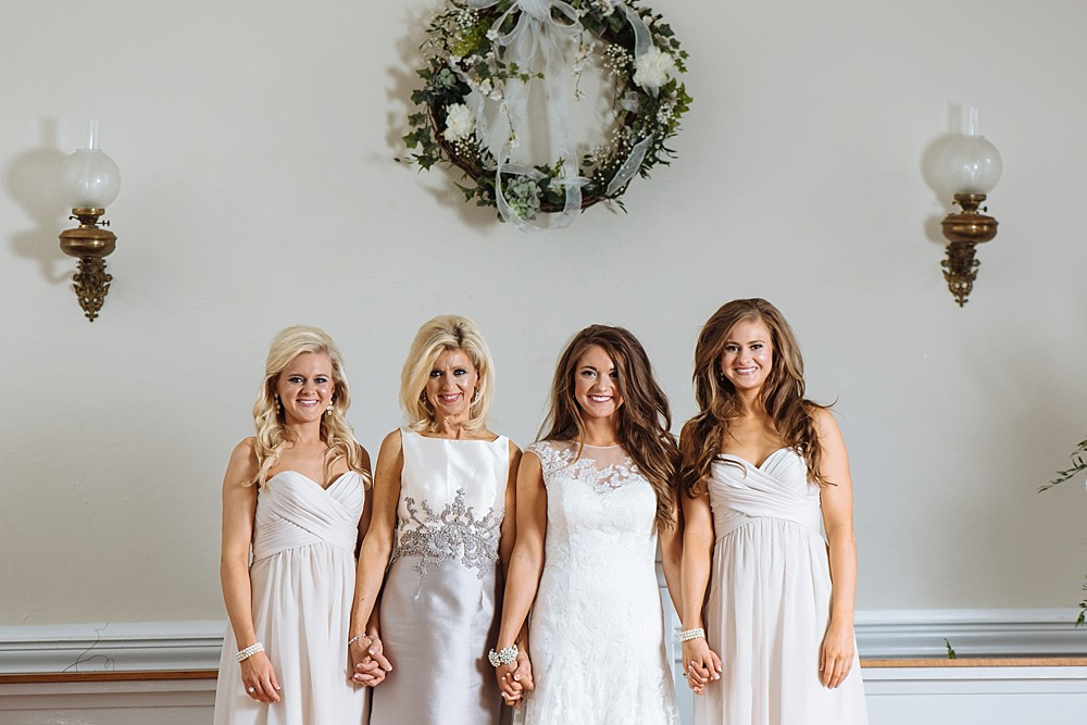 Bride with mother and sisters, historic church