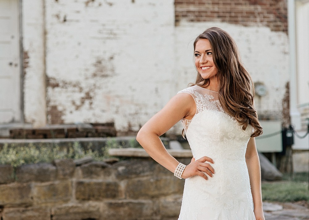Bridal Portrait at Carnton Plantation in Franklin TN. Simple, Beautiful. Bride Smiling. Brick background. Rustic