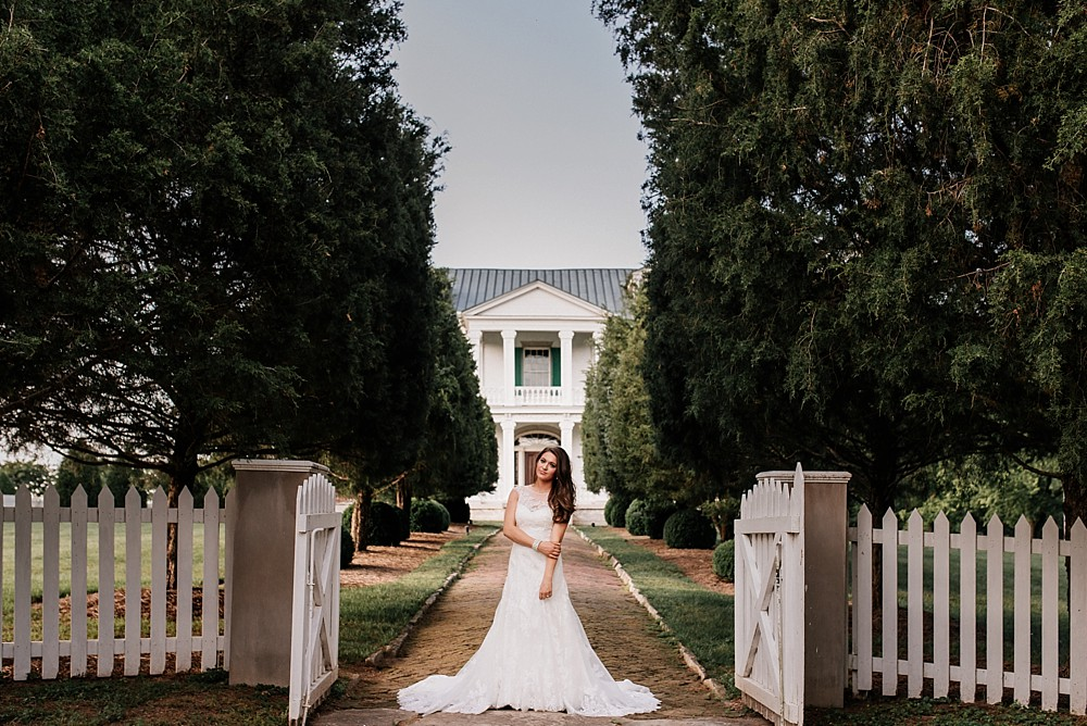 Bridal Portrait at Carnton Plantation in Franklin TN. Simple, Beautiful. Bride Smiling. Wood Door background. Rustic. Historic home from the civil war.