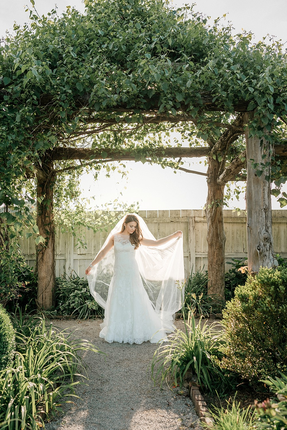 Bridal Portrait at Carnton Plantation in Franklin TN. Simple, Beautiful. Bride Smiling. Beauty and grace. Sun shining through. Backlit.