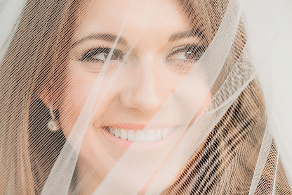 Bridal Portrait at Carnton Plantation in Franklin TN. Simple, Beautiful. Bride Smiling. Beauty and grace with veil over face.