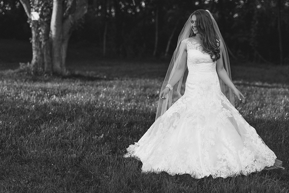 Bridal Portrait at Carnton Plantation in Franklin TN. Simple, Beautiful. Bride Smiling. Fun black and white portrait.