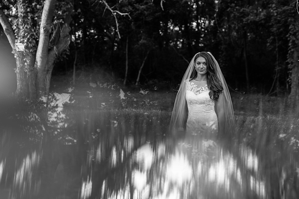 Bridal Portrait at Carnton Plantation in Franklin TN. Simple, Beautiful. Bride Smiling. Artistic with Prism.