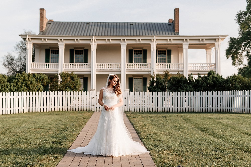 Bridal Portrait at Carnton Plantation in Franklin TN. Simple, Beautiful. Bride Smiling. Looking into the sunset in front of historic home.