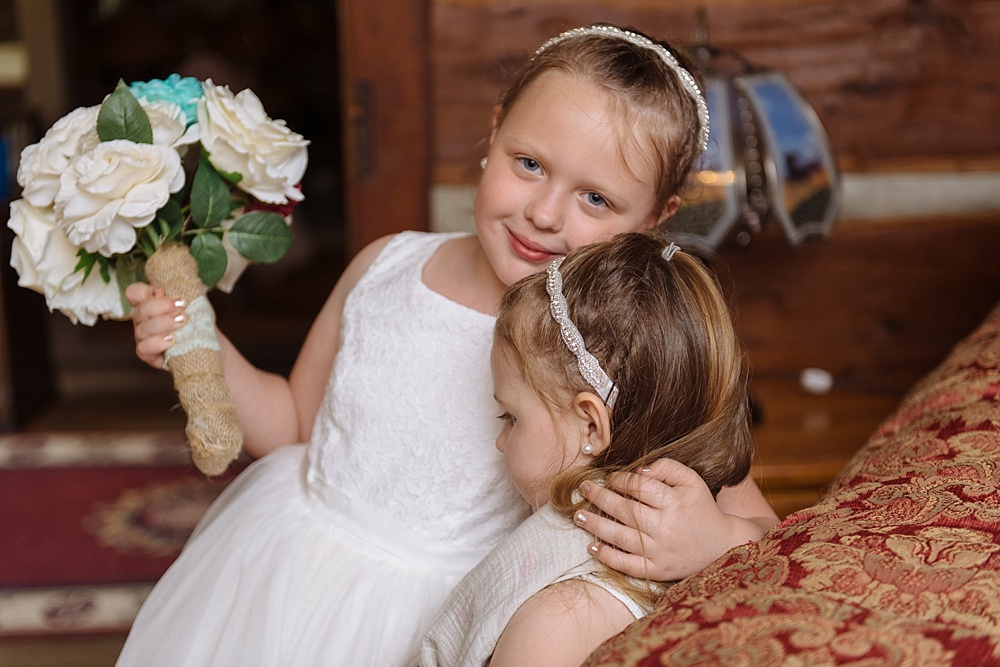 Flower girls loving on each other