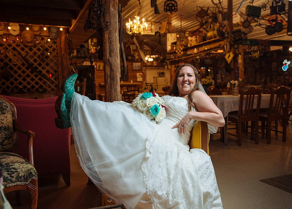 Bride with turquoise cowgirl boots sitting in yellow chair