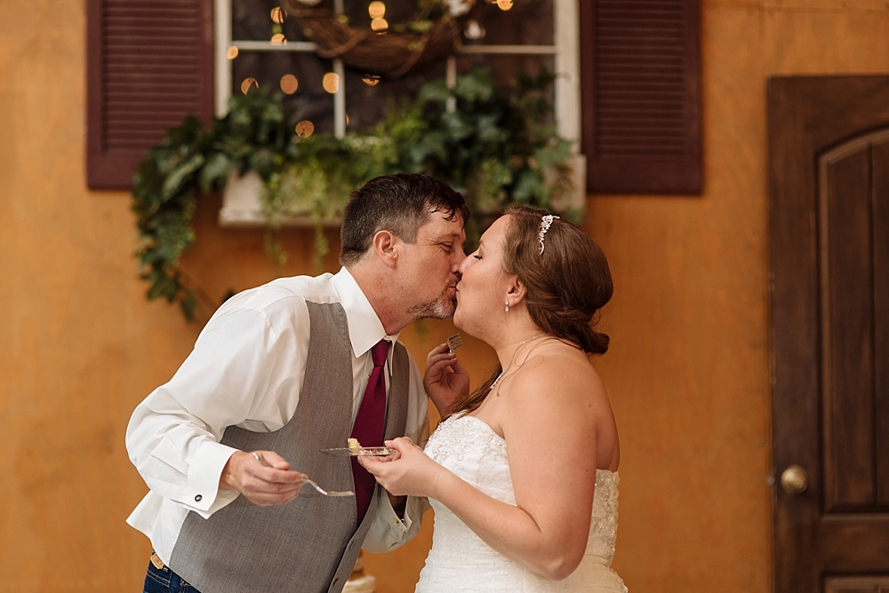 Bride and Groom Kiss after cake